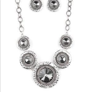 Silver necklaces.